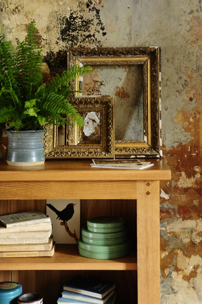 Oak bookcase, rustic oak, rustic wall, antique golden frames, blue pottery