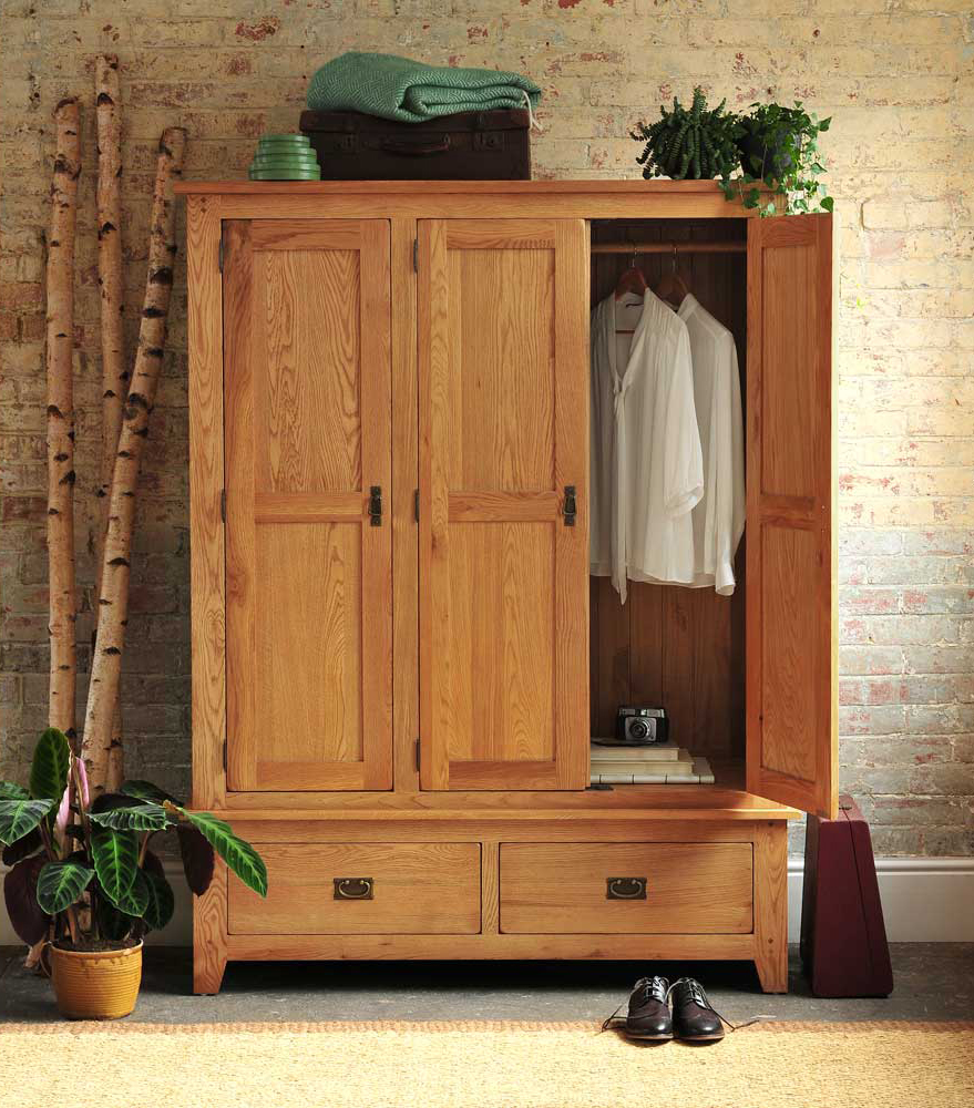 Rustic Oak wardrobe, Rustic bedroom furniture, muted greens, plants, exposed brick wall