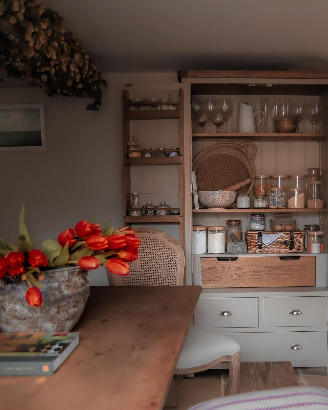Our Lundy Stone kitchen larder offers ample storage space in Emma's cottage kitchen