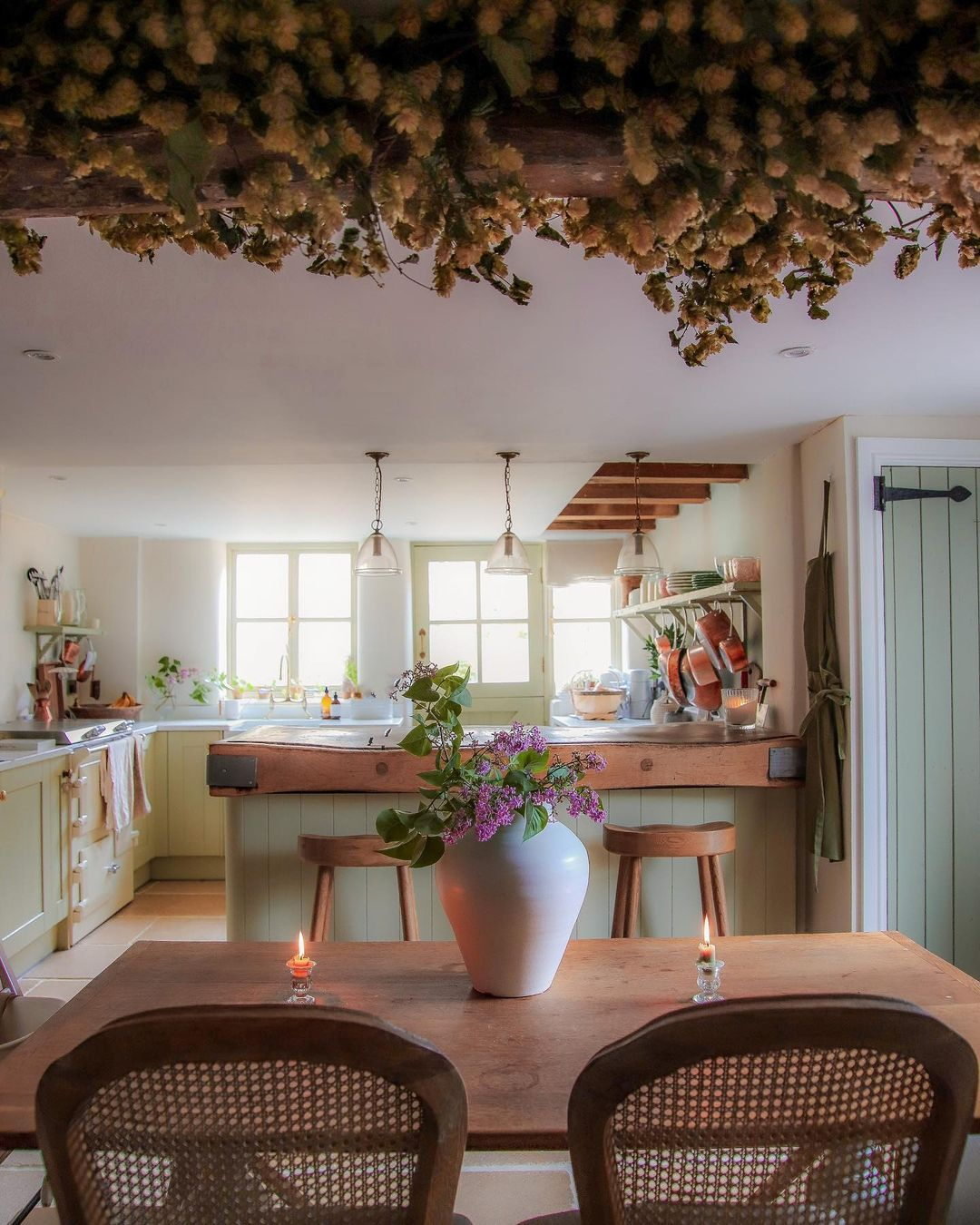 A charming traditional cottage kitchen featuring our Camille Oak dining chairs