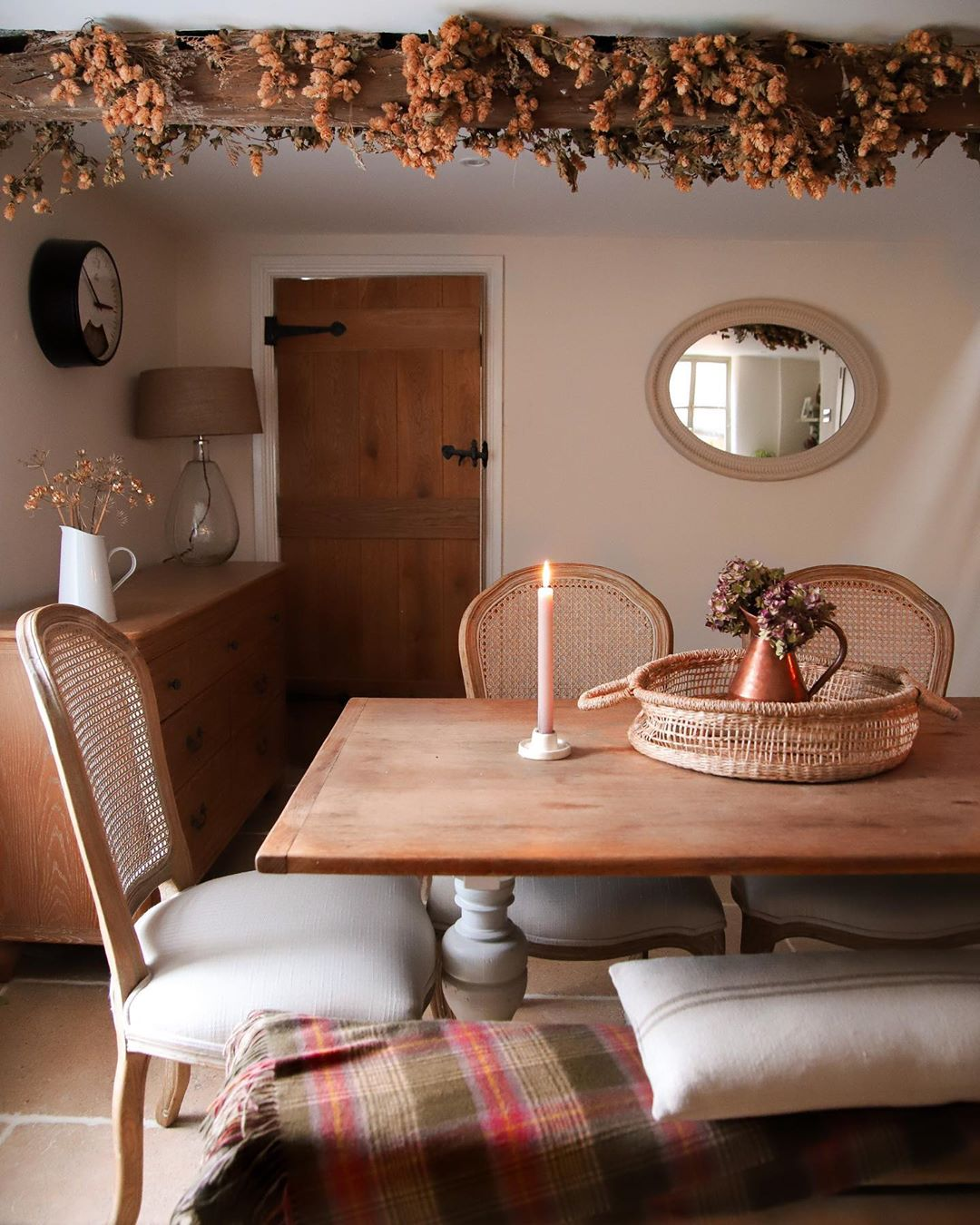 A seasonal cottage kitchen featuring our Camille Oak dining chairs