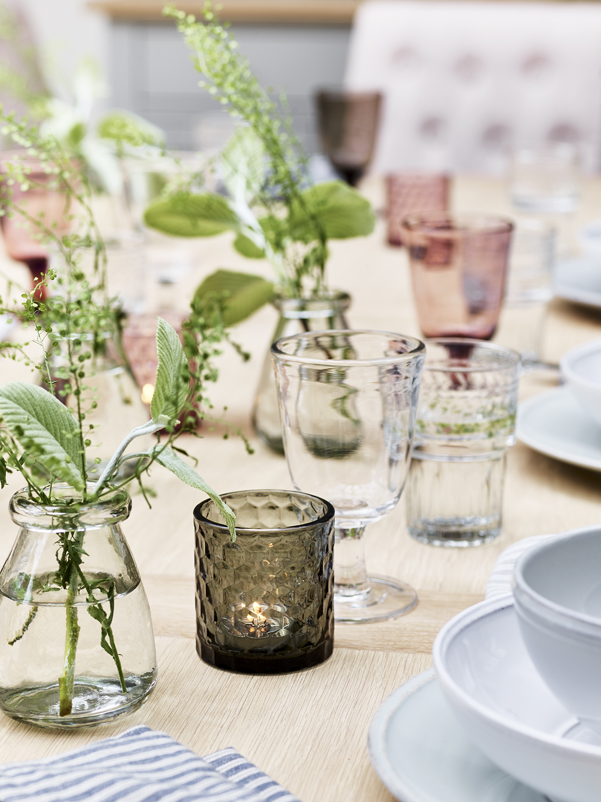 Coloured glassware and bud vases bring texture and seasonality to tablescapes